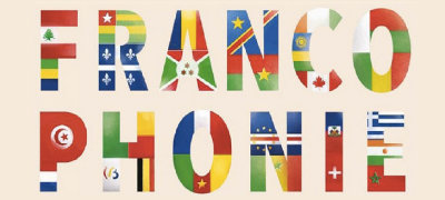 Written word 'Francophonie' with many flags behind it